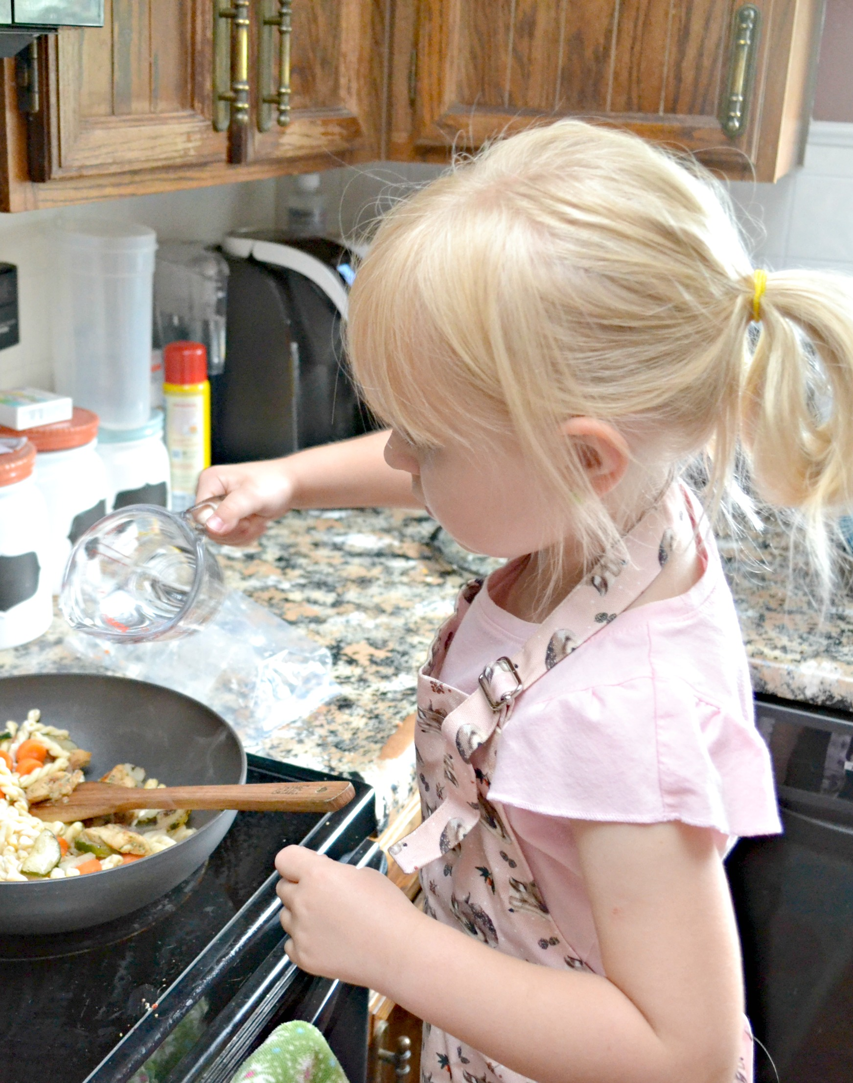 tips on getting kids into the kitchen, cooking with kids, making memories while making dinner, how to cook with kids, easy dinner ideas, Tyson Frozen Meal kits, easy dinner recipes, easy recipes, easy family meals
