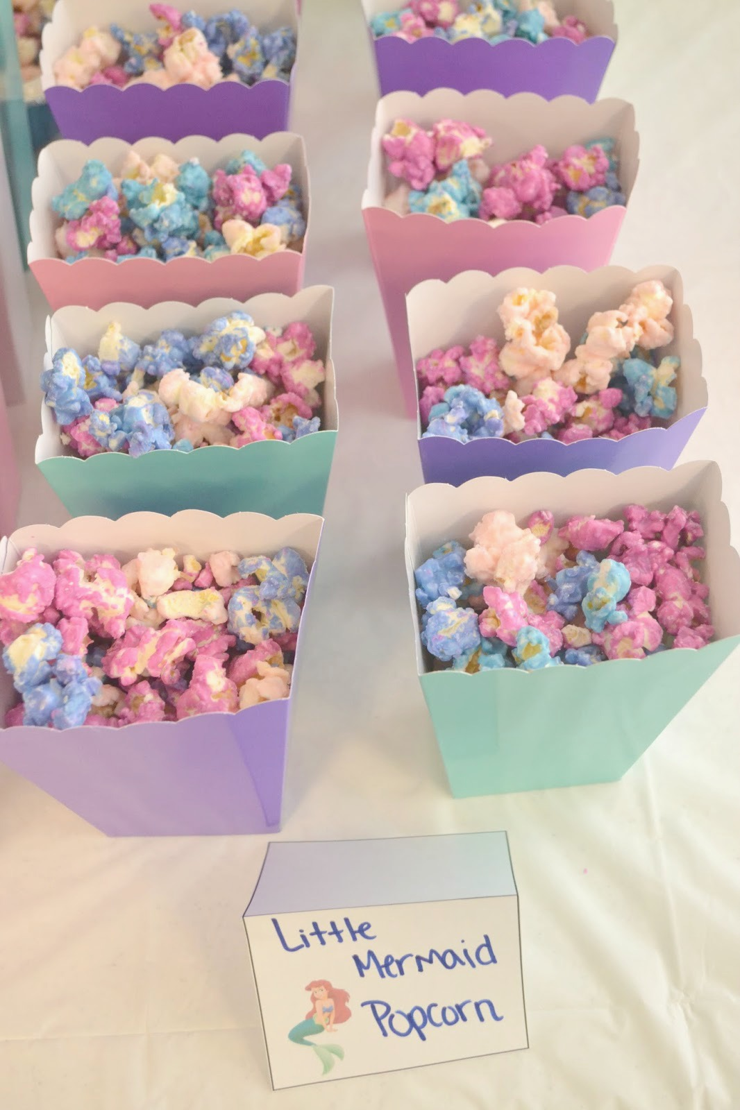 Little Mermaid popcorn, Coral pieces popcorn for mermaid party, mermaid party food, Mermaid popcorn, Mermaid coral pieces popcorn, Little Mermaid Birthday Party Ideas, Little Mermaid Birthday Party, Little Mermaid Birthday, Little Mermaid party food, little mermaid themed party ideas, Little Mermaid Birthday Party food, Little Mermaid Birthday Party decorations, goodie bag ideas for little mermaid party