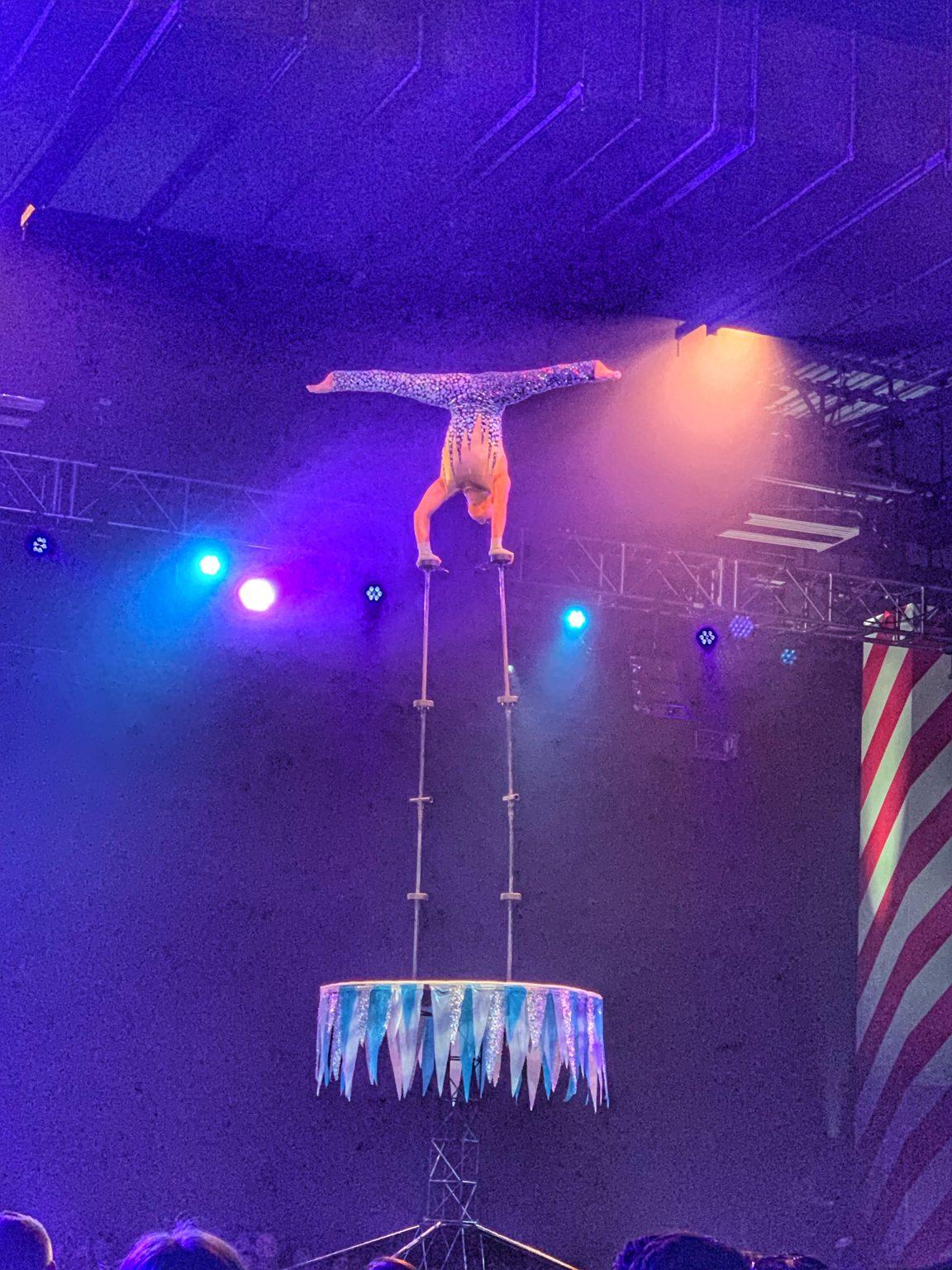 Chen Lei balances upside down on tall poles