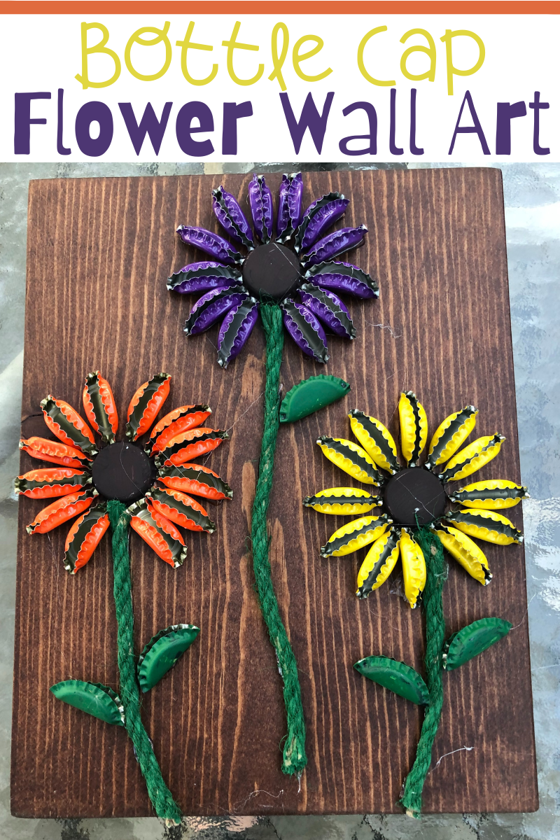 Bottle Cap Flower Wall Art. Create your own Bottle Cap Flower Wall Art. DIY - A great craft for all ages. Brighten up your wall with these fun bottle cap flowers!